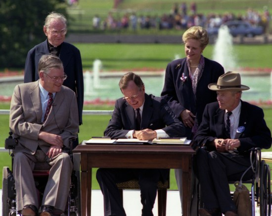 President George H. W. Bush Signs the Americans with Disabilities Act, July 26, 1990. (National Archives Identifier 6037489)
