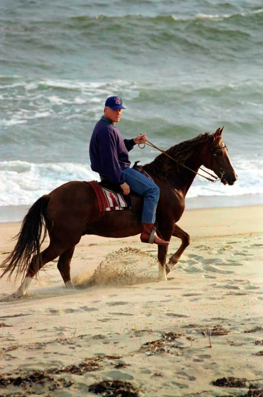 President William J. Clinton take a horseback ride on the beach at Martha's Vineyard in Massachusetts.  8/31/94.
