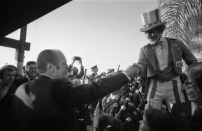 President Gerald R. Ford shaking hands with a man dressed as Uncle Sam at McCoy Air Force Base in Orlando, Florida, 2/13/1976. (National Archives Identifier 30805917)