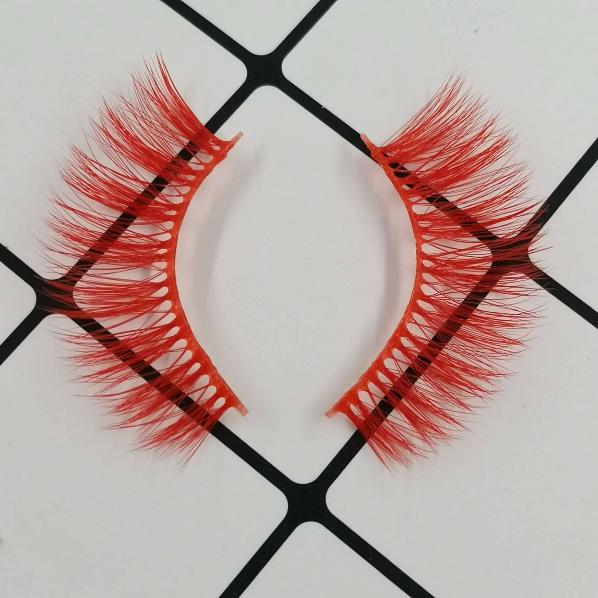 A pair of colored eyelashes for your eye shape and its color is red. Trust me, ProluxuryLashes brand is the best eyelash supplier
