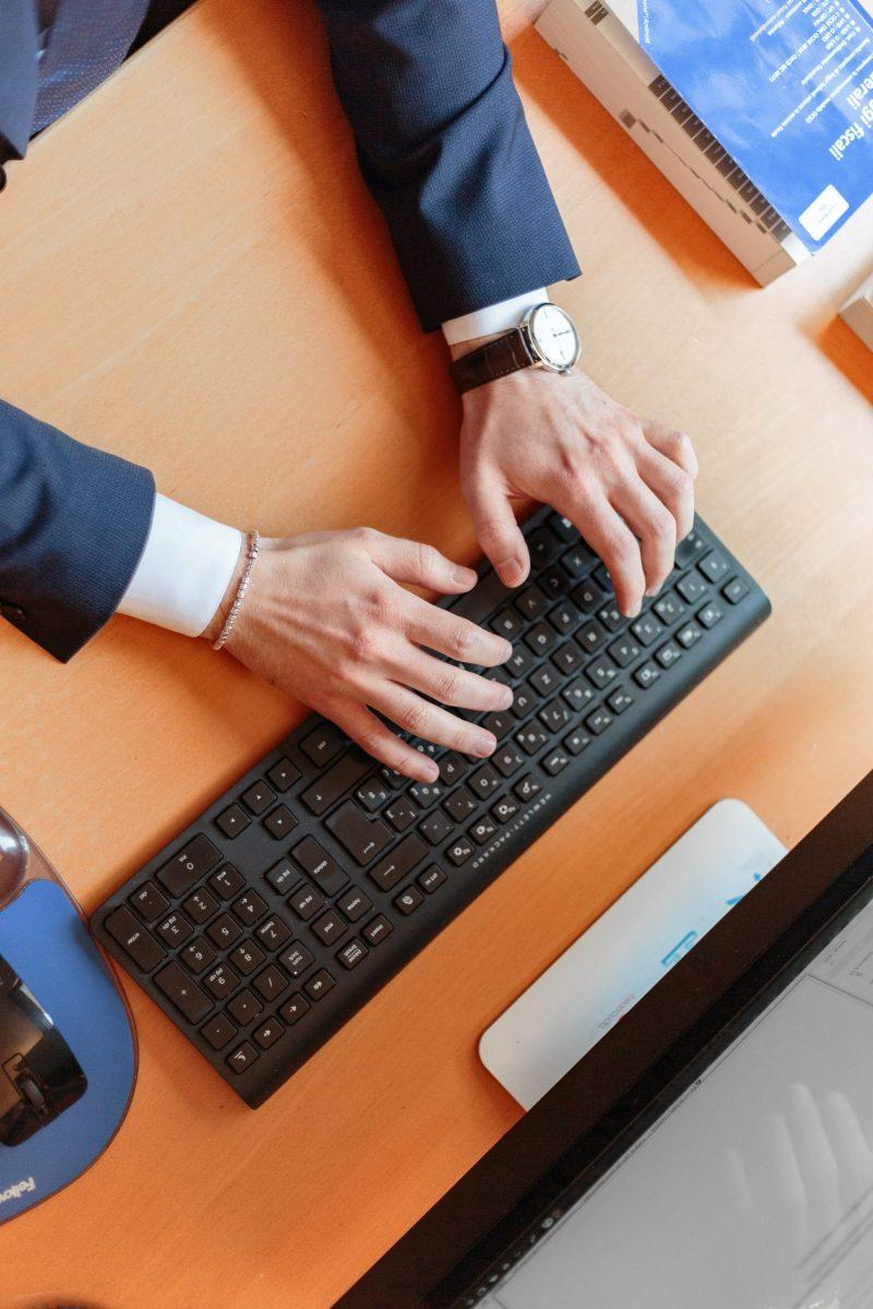 man-typing-on-computer-keyboard-2058131