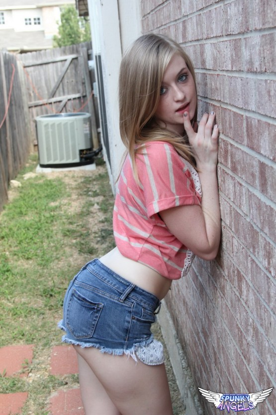 Sexy little Mandy Roe teases with her round juicy ass in tiny jean shorts that she promptly strips out of