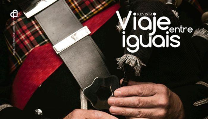 Capa da revista Viaje entre Iguais com homem tocando gaita de fole