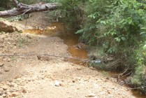 in other areas the cable passes through puddles and streams then return about ground