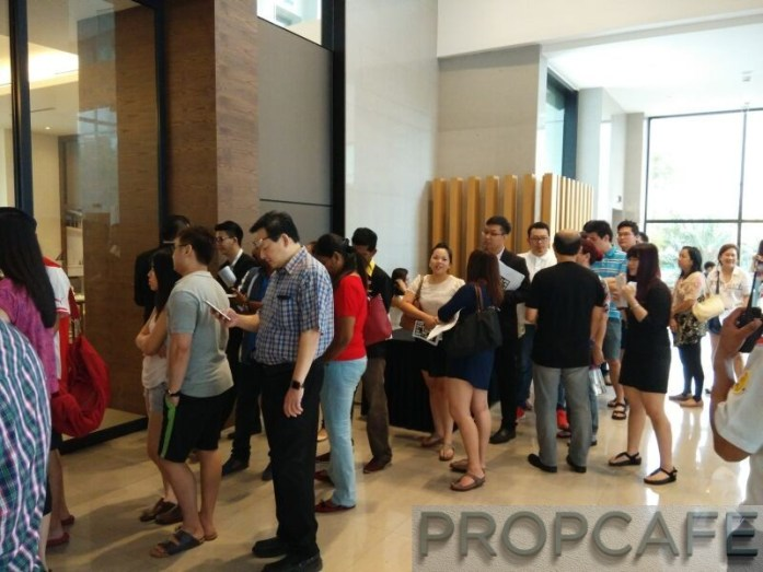 REV.O Lifestyle Suites Bukit Jalil City Launching Event. Queuing patiently waiting for their turn to go in as there is crowd control inside the sales gallery. Taken before noon