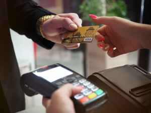 photo of person handing card