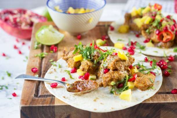 chicken tacos with jerk sauce and pomegranate