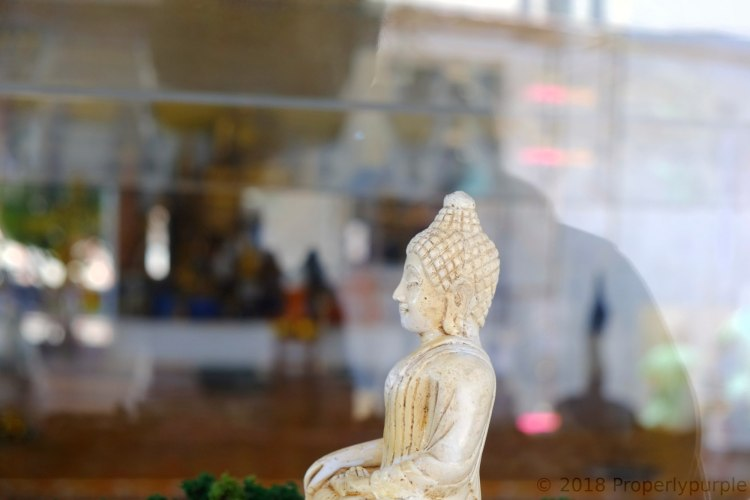Statue of Buddha in a glass box, near large Buddha statue in Phuket, Thailand