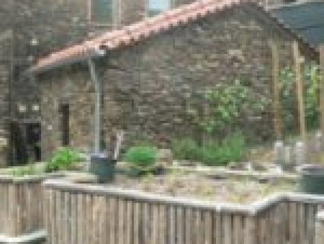 Schist-Casita-Small-Detached-Storage-House-with-Boiler-and-Wood-Raised-Beds-for-Gardening