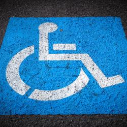 large blue and white ada compliant parking space marking