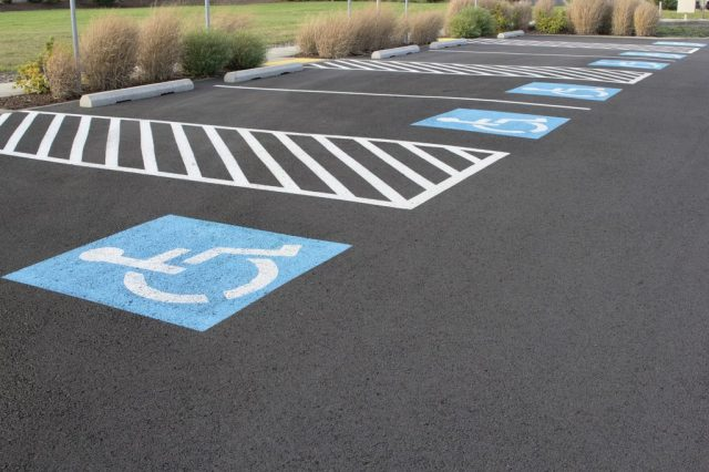 ADA compliant parking space markings on blacktop