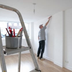 The right residential painter performing an interior repaint