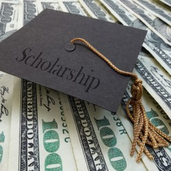NAHMA Scholarship Represented by graduates cap on money background
