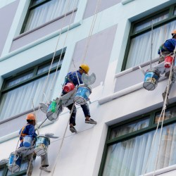 Commercial Painters Painting Exterior of High Rise Apartment Building Hiring Apartment Painting Contractors