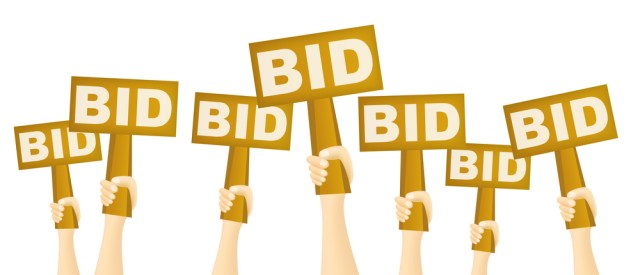 Hands Holding Bid Signs Up In The Air For BidSource Blog
