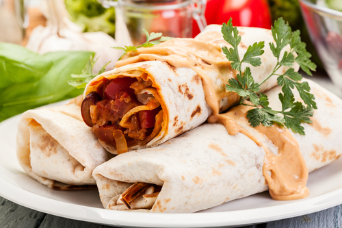 Three Burritos on Platter For Top Apartment Resident Events Ideas For April Blog