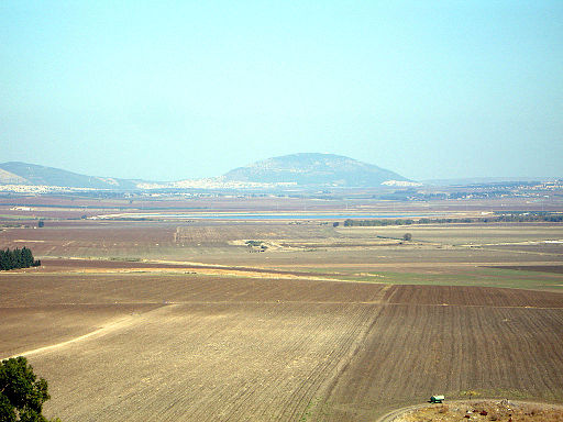 Colored photograph of Jezreel Valley, very flat land, with Mt Tabor in background. Is Kim Jong-Un in bible prophecy?