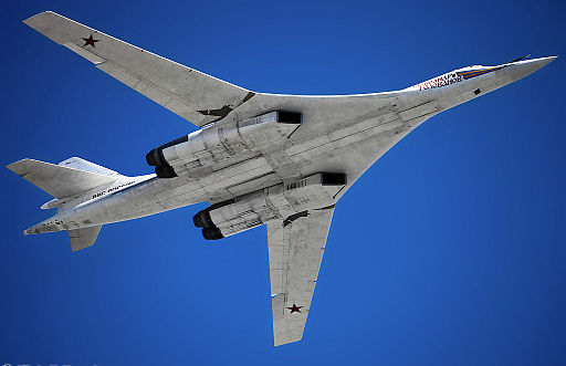 Colored photograph of a jet bomber from the underside. Blue sky. white aircraft. Meet Gog?