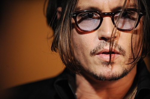 Johnny Depp wearing TART OPTICAL / ARNEL