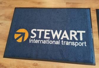 Stewart int trans logo mat 1