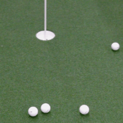 Still-Capture-pro-Putt-Turf-w-Balls-and-Cup-resized-image-560x350