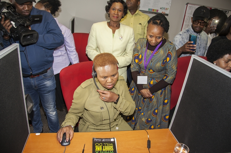 Minister Lindiwe Zulu taking a call in the Gender-Based Violence Command Centre