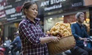 Street vendor Hanoi Vietnam with her basket full of food
