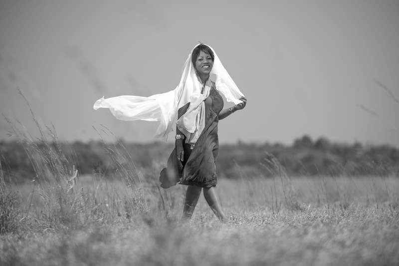 Woman with scarf blowingin wind | ProSelect-images