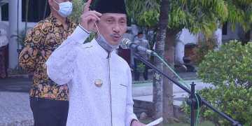 Bupati Gorontalo, Nelson Pomalingo, Saat Memberikan Sambutan Pada Penyerahan Surat Keputusan (SK) Kepada 242 CPNS, Jumat (15/01/2021). Foto: Humas Kominfo Kabgor.