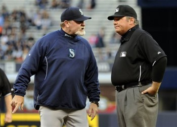 Seattle Mariners manager Eric Wedge, left, talks with first base umpire Hunter Wendelstedt after he was ejected during the second inning of a baseball game against the New York Yankees, Thursday, May 16, 2013, at Yankee Stadium in New York. (AP Photo/Bill Kostroun)