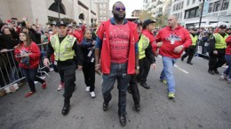 Boston Red Sox designated hitter David Ortiz walks towards the finish line of the Boston Marathon during a parade in celebration of the baseball team's World Series win, Saturday, Nov. 2, 2013, in Boston. (AP Photo/Charles Krupa)