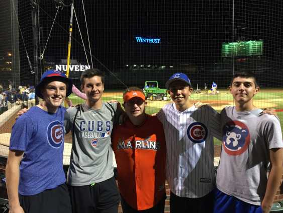 Writer junior Jack Ankony (second to right) and his friends pose with the Marlins Man at a Cubs game at Wrigley.