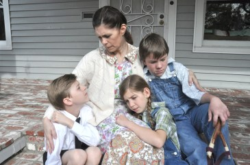 jenni on porch with kids