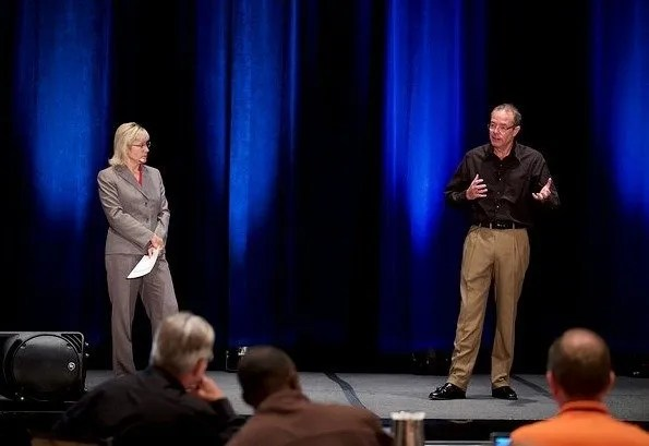 Kim Butler and Todd Langford on stage at The Summit for Prosperity Economics Advisors, 2015.