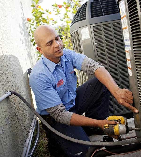 Pro-Tech technician performing air conditioning maintenance Orlando