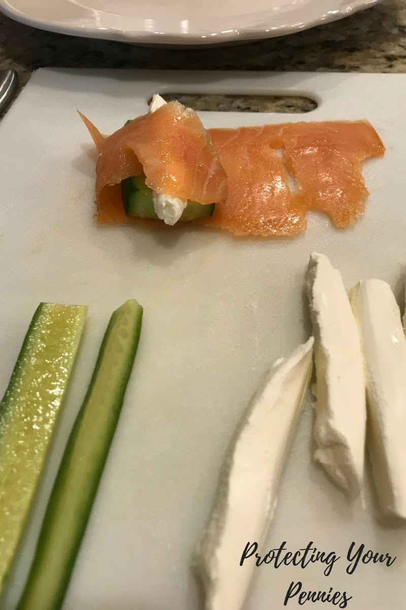 Making a cream cheese and salmon roll
