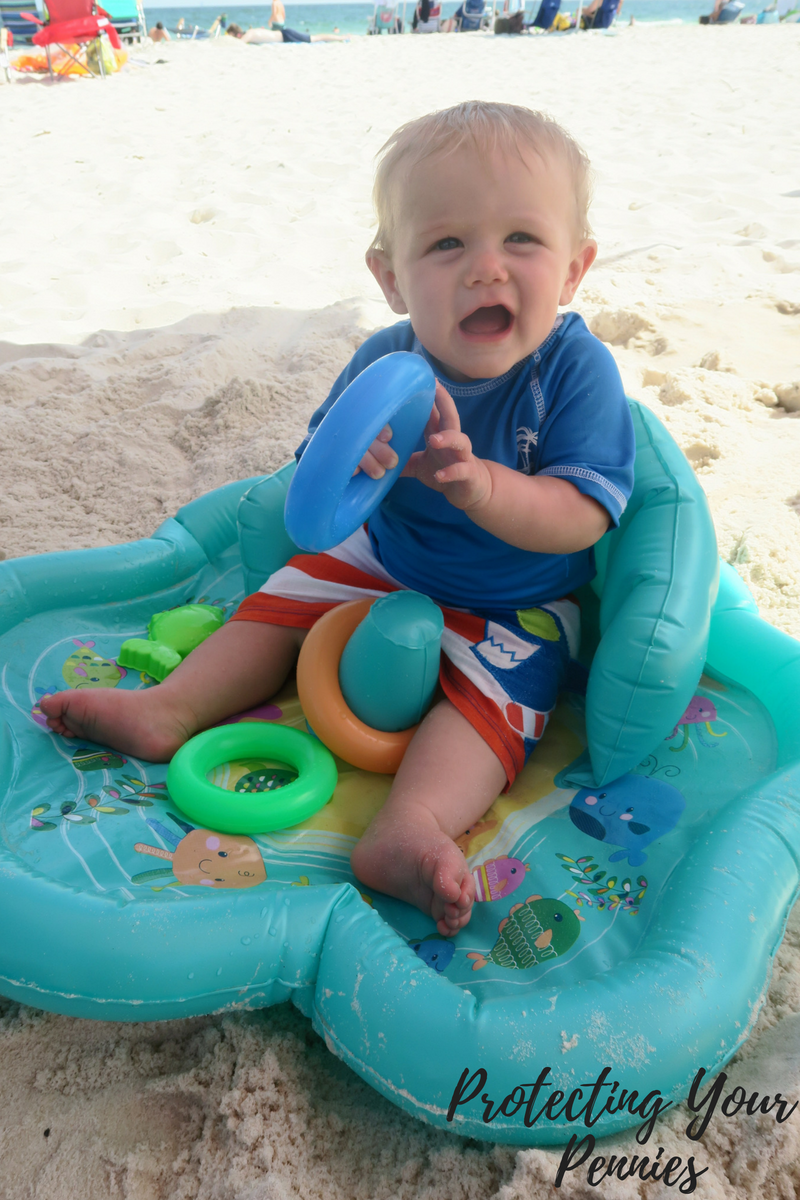 Baby in Splash Pad Pool on Bed