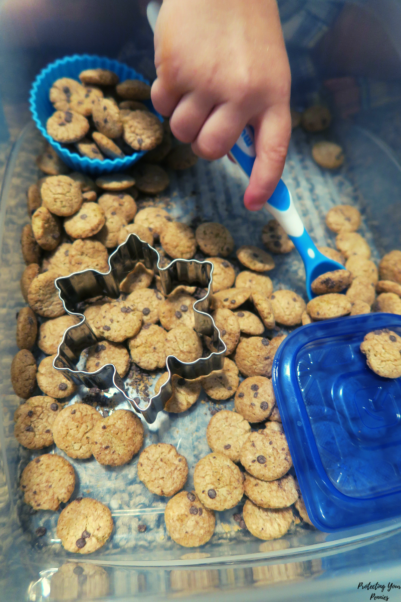 Cookie Cereal Sensory Bin For Fine Motor Skill Development