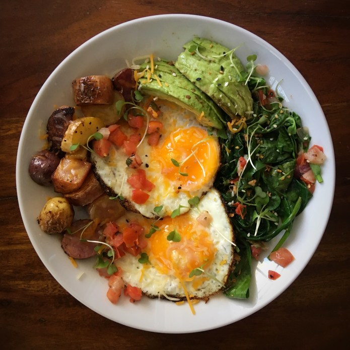 Eggs, Potatoes, Spinach, and Avocado Breakfast