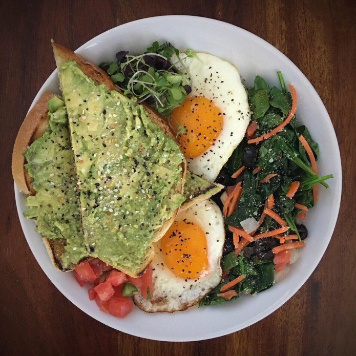 Avocado Toast, Two Fried Eggs, Spinach Salad, Pico de Gallo, and Microgreens for Breakfast