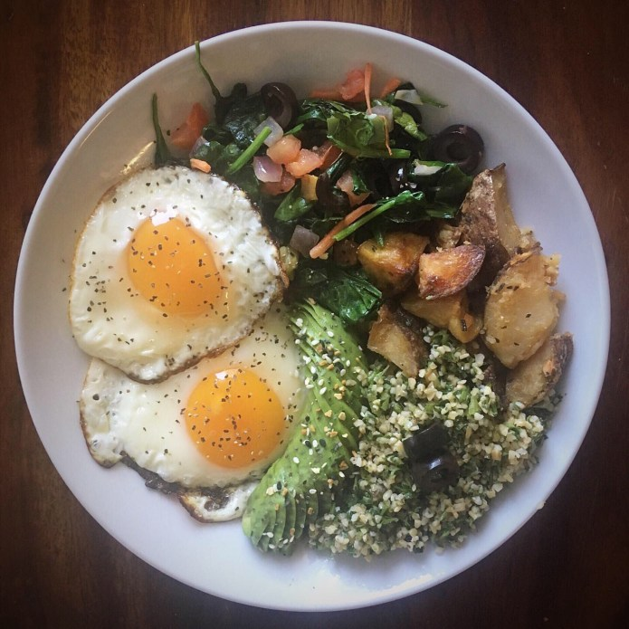 Two Fried Eggs, Spinach Salad, Potatoes, Avocado, and Tabouleh Salad
