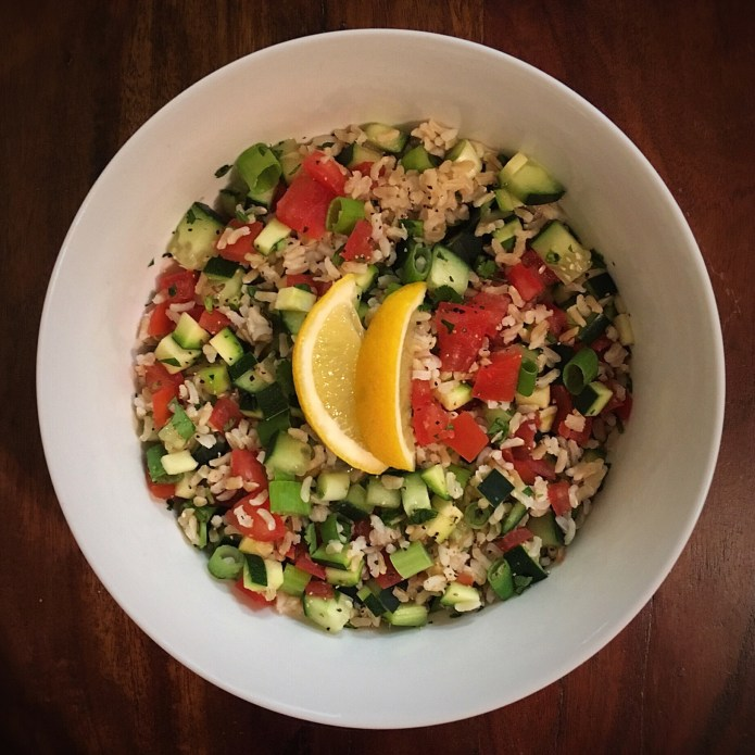 Brown Rice Salad Bowl with Cucumber, Zucchini, Tomato, Green Onion, and Lemon