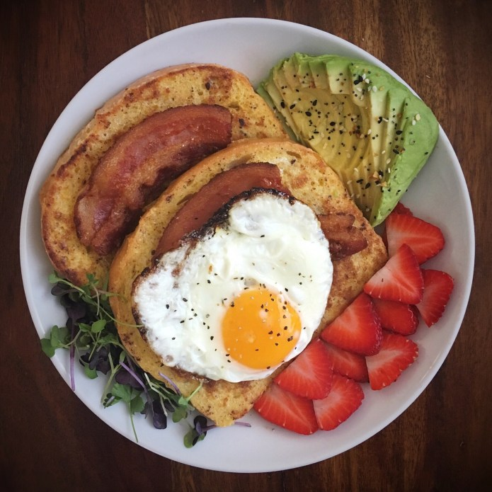Breakfast Party of French Toast, Fried Egg, bacon, Avocado, Microgreens, and Fresh Cut Strawberries