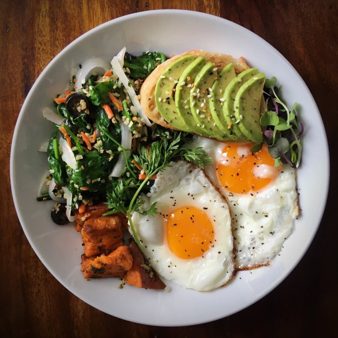 Avocado Toast on French Baguette, with Fried Eggs, Spinach and Tabouleh Salad, and Sweet Potatoes