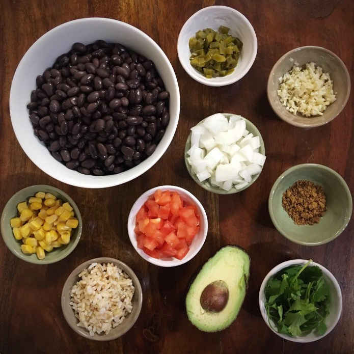 Black Bean Mise En Place with Jalapeño Peppers, Onions, Garlic, and Cumin, Tomatoes, Corn, Brown Rice, Avocado, and Cilantro