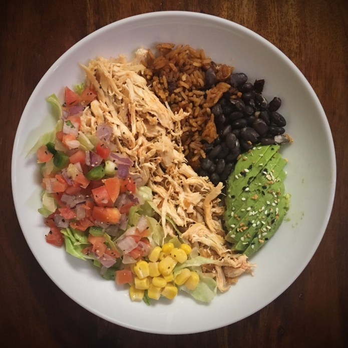 Burrito Bowl with Chicken, Spanish Rice, Black Beans, Avocado, Pico de Gallo, Corn, and Lettuce