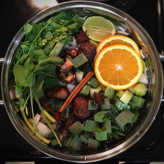 This Pho Broth Recipe includes Oranges, Limes, Onions Leeks, Mushrooms Cinnamon, Star Anise, Basil, Peppercorns