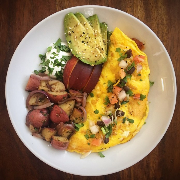 Chili Omelette with Potatoes and Onions, Avocado, Pico, and a Peach