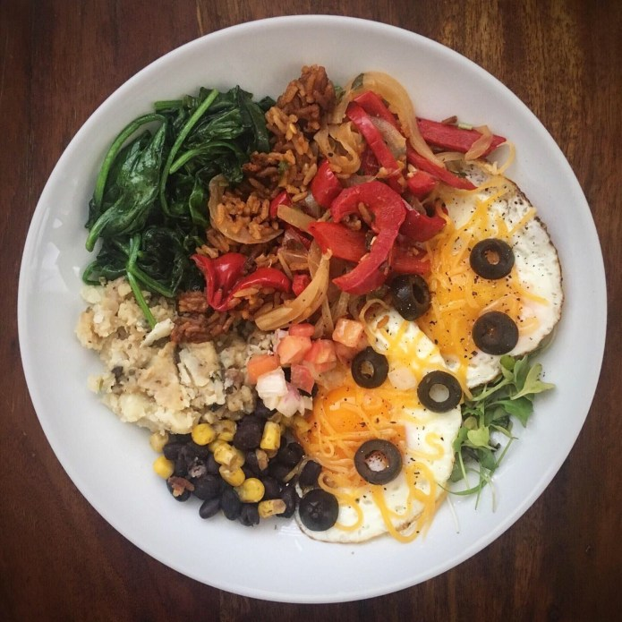 Fajita Breakfast Platter with Peppers and Onions, Spanish Rice, Spinach, Mashed Potatoes and Gravy, Beans, Corn, Eggs, Cheese, Olives, and Microgreens