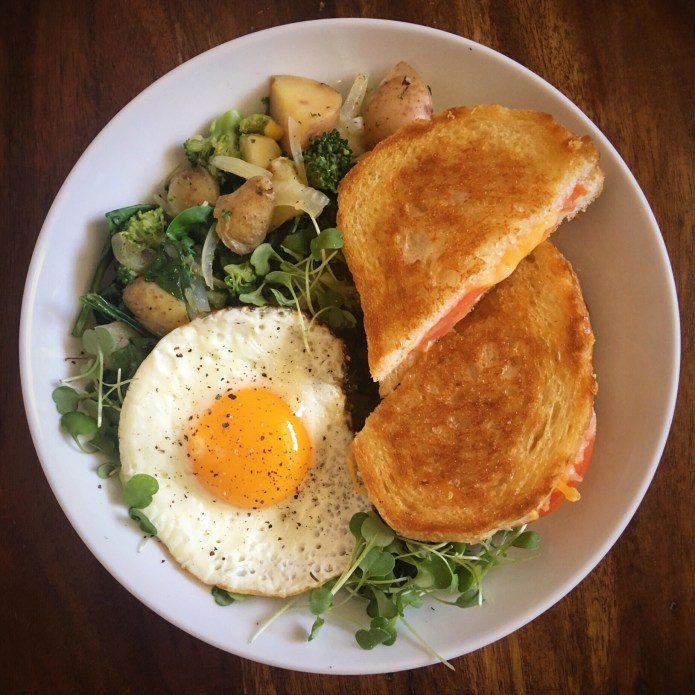 Grilled Cheese Sandwich with Tomato, side of Fried Egg, Spinach, Onion, Mushrooms, Broccoli, and Microgreens